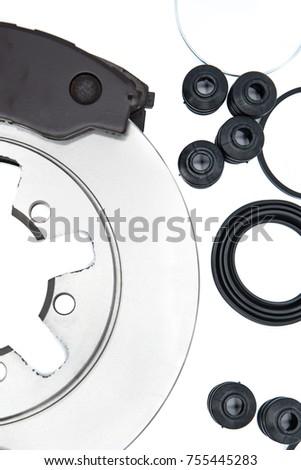 Automotive Spare Parts of disk brake pads, disc brake caliper piston, disk brake repair kIt and rotating brake disk on white background. #755445283