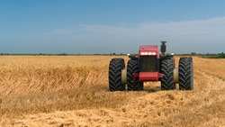 Autonomous tractor working in the field. Smart farming and digital transformation in agriculture