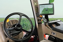Autonomous tractor working on the field. Smart farming