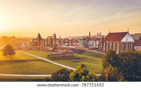 Autumm fog over Kaunas old town, Lithuania. Sunrise moment. Drone aerial view
