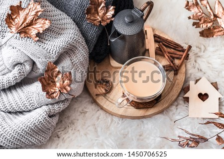 Autumn and winter home still life . The view from the top. The concept of home atmosphere and decor. Wooden houses with carved heart and autumn Golden leaves. #1450706525