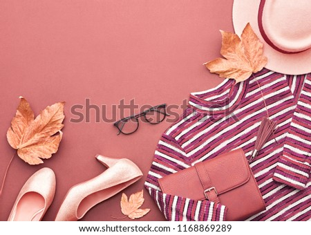 Autumn Arrives. Fashion Lady Clothes Outfit. Trendy Knit Jumper, Hat. Stylish Handbag Clutch, Glamour Shoes, Glasses, Leaves. Fall mood. Creative Flat lay. Pastel burgundy color.