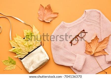 Autumn Arrives. Fashion Lady Clothes Set. Trendy Cozy Knit Jumper. Stylish Handbag Clutch, Vintage. Fall Leaves. Vanilla Pastel colors. Flat lay.