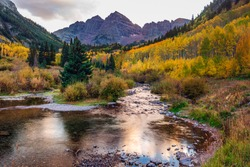 Autumn aspen trees reflected in the lake. Maroon bells at autumn season in in Aspen Colorado, USA.