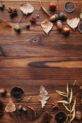 Autumn background, border made of dried leaves and acorns with copy space. Seasonal composition, fall, thanksgiving day concept. Flat lay, top view
