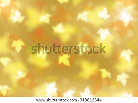 Autumn background. Gold background. Blurred golden leaves flying in the air. Fall background. Maple leaf. Nature bokeh background. Magic autumn concept. Fall season. Autumn leaves. Season background.