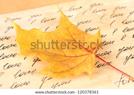autumn background:romantic letter and leaves