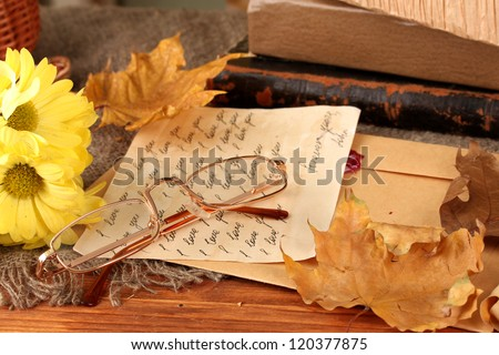 autumn background:romantic letter, glasses and leaves