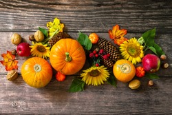 Autumn Background, Thanksgiving table. Pumpkins, sunflowers, apples and fallen leaves. Top view flat lay.
