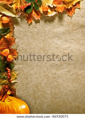autumn background with colored leaves and pumpkin on old paper
