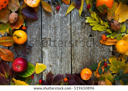 Autumn background with colored leaves on wooden rustic background with copy space