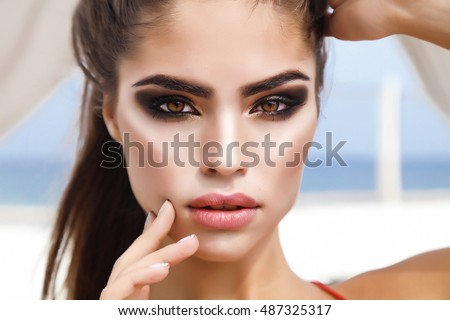 Autumn Beauty portrait Girl with Vivid Makeup and colorful Nail polish.Colourful nails.Fashion Woman portrait close up. Bright Colors. Manicure Make up. Smoky eyes, long eyelashes. Rainbow Colors,gold