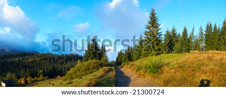 Autumn beginning morning in Carpathian mountain, Ukraine. With moon under trees and designedly keep photographer shadow in right bottom corner. Seven shots stitch image.