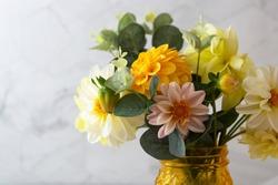 Autumn bouquet with fresh dahlia yellow, white, pink flower