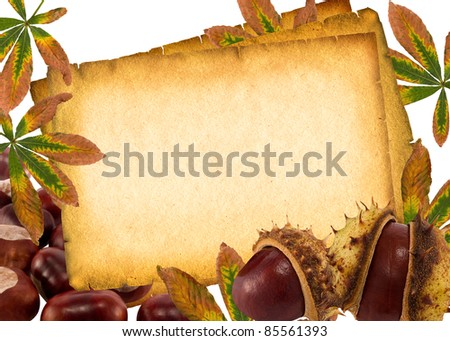 Autumn chestnuts and leaves on old paper background.