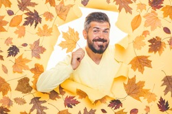 Autumn clothing and color trends. Men casual fashion. Handsome man with autumn leaves