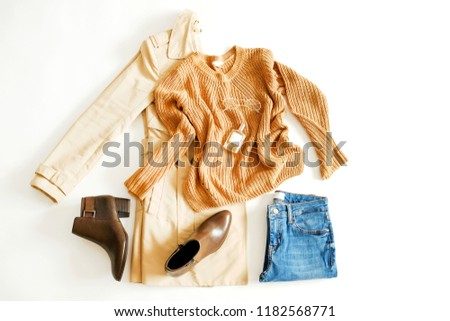 Autumn clothing essentials ideas for fashion blog look book showcase. Casual set of matching garment items. Trendy mass market apparel concept. Background, copy space, close up, top view, flat lay. #1182568771