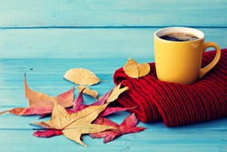 Autumn coffee over blue wood