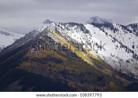 Autumn color with snow in mountains near McClure Pass Colorado