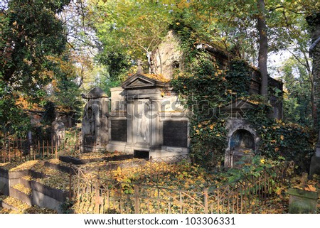 Autumn colorful mystery old Prague Cemetery Olsany, Czech Republic