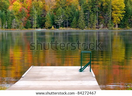 Autumn colors are reflected in the  calm lake waters
