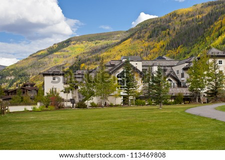 Autumn colors in Colorado. View of homes near mountain slops.