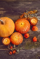 autumn composition. cozy fall season. pumpkins, autumn leaves, candles on wooden background. thanksgiving holiday, Halloween concept