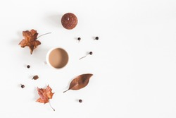 Autumn composition. Cup of coffee, autumn plants on white background. Flat lay, top view, copy space