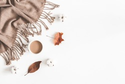 Autumn composition. Cup of coffee, plaid, dried leaves on white background. Autumn, fall concept. Flat lay, top view, copy space
