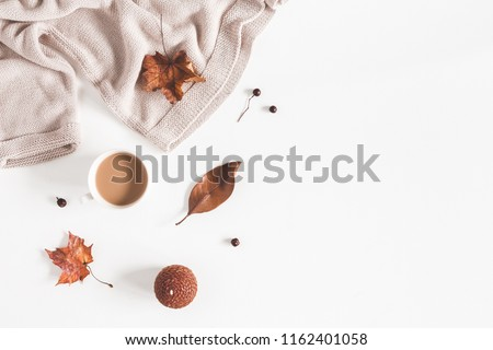 Autumn composition. Cup of coffee, women fashion csweater, autumn leaves on white background. Flat lay, top view, copy space #1162401058