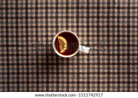 Autumn composition. Cup of tea, plaid. Flat lay.