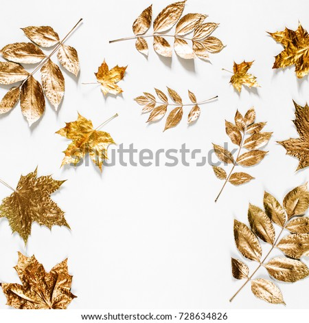 Autumn composition. Frame made of autumn golden  leaves on white background. Flat lay, top view, copy space