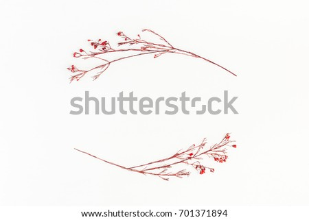 Autumn composition. Frame made of autumn red flowers. Flat lay, top view, copy space