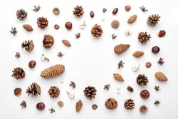 Autumn composition, frame made of pine cones, acorns and chestnuts. Flat lay, top view.
