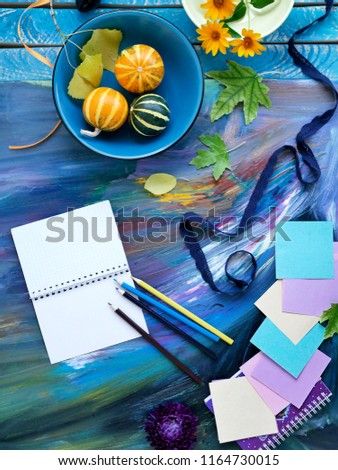 Autumn composition of decorative pumpkins, flowers, art and stationery on a bright background. Preparing for the holiday, Halloween, school #1164730015