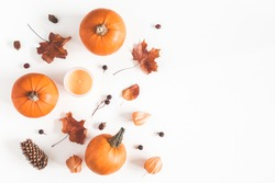 Autumn composition. Pumpkins, candles, dried leaves on white background. Autumn, fall, halloween concept. Flat lay, top view, copy space