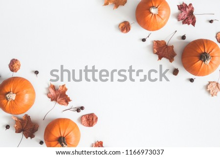Autumn composition. Pumpkins, dried leaves on pastel gray background. Autumn, fall, halloween concept. Flat lay, top view, copy space #1166973037