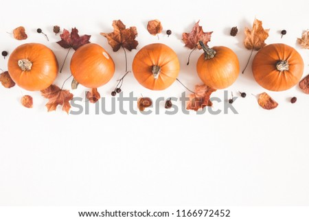 Autumn composition. Pumpkins, dried leaves on white background. Autumn, fall, halloween concept. Flat lay, top view, copy space - Shutterstock ID 1166972452