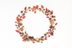 Autumn composition. Wreath made of autumn leaves, pine cones, anise star. Flat lay, top view, copy space.