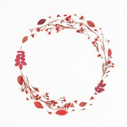 Autumn composition. Wreath made of autumn red leaves and flowers. Flat lay, top view, copy space