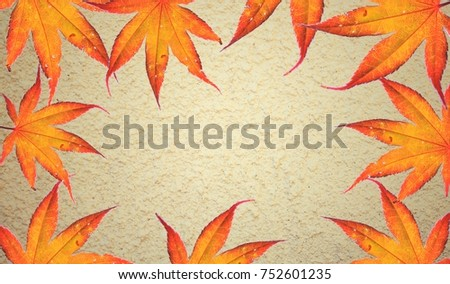 Autumn concept, background, yellow cement background  with red and yellow leaves, top view, frame. Maple leaf change the color . Turn to orange . Use for autumn , Holiday , cold season , presentation Photo stock ©