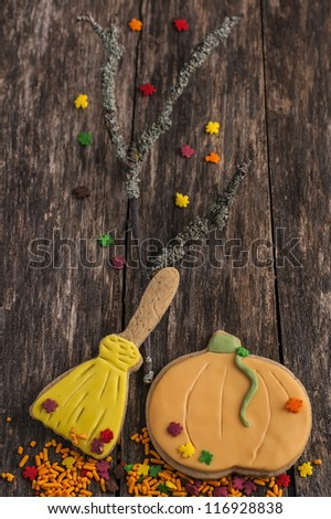 Autumn cookies for Halloween on old wood table