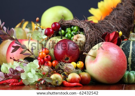 Autumn cornucopia with various fruits and vegetables - symbol of food and abundance