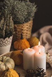 autumn cosy candles, pumpkin, and blanket