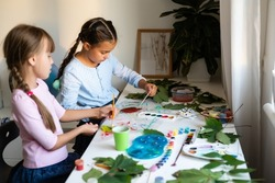 autumn craft for kids. animal Fox made from maple leaf. childrens art and creative. handicraft made from natural materials. girls draws with paints.