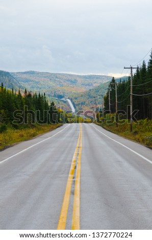 Autumn endless road under cloudscape, Quebec, Canada #1372770224