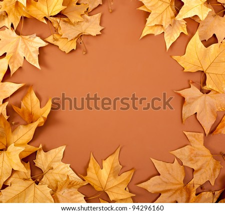 autumn fall dried leaves border fame on brown background copyspace - stock photo
