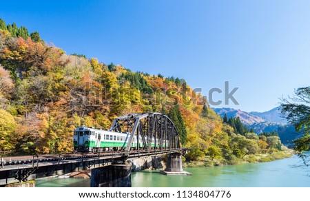 Autumn fall foliage Fukushima Tadami Black Bridge View Point in Fukushima Japan #1134804776