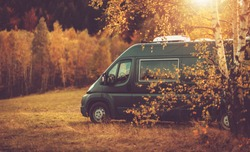 Autumn Fall Foliage RV Recreational Vehicle Camper Van Road Trip and Scenic Camping in Beautiful Place. Motorhome and the Scenic Nature. Travel Theme.