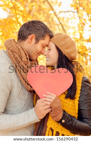 autumn fall happy smiling embracing couple